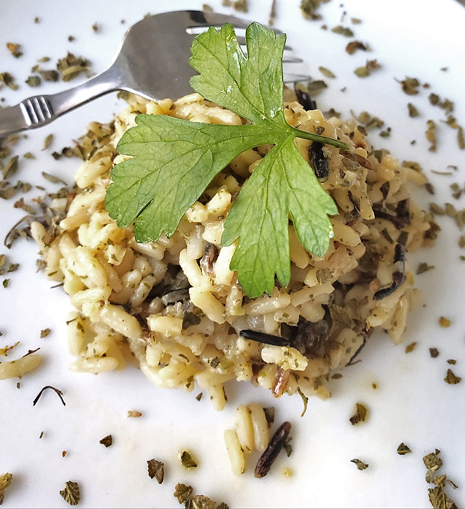 this is a scoop of long grain and wild rice and how to make it from scratch on a white plate recipe