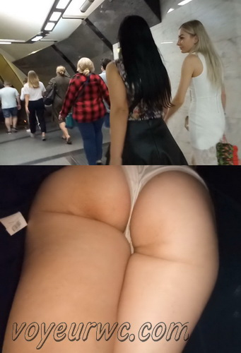 Upskirts 4379-4388 (Secretly taking an upskirt video of beautiful women on escalator)