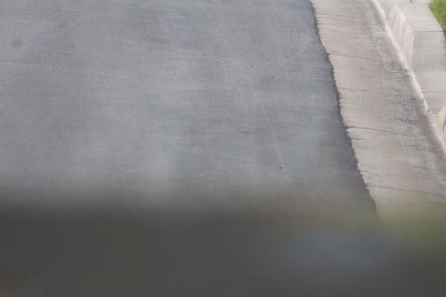 Reflection off of asphalt roadway, DSLR, 300mm, 1/125 sec (Source: Palmia Observatory)