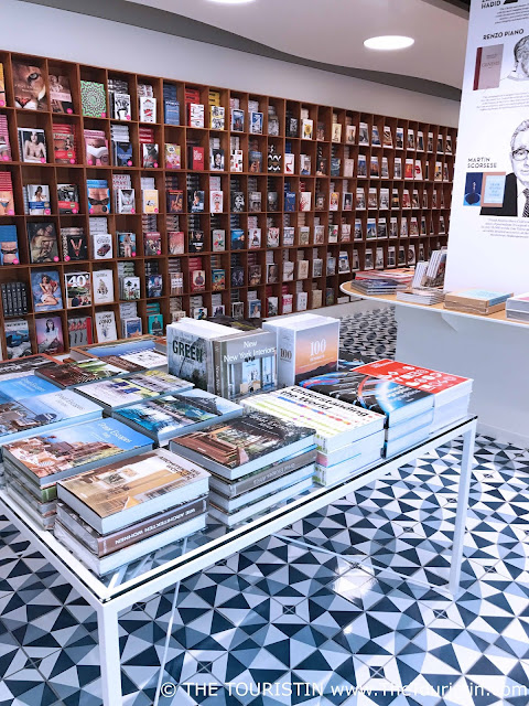 Book shelves, blue tiles on floor and table with books