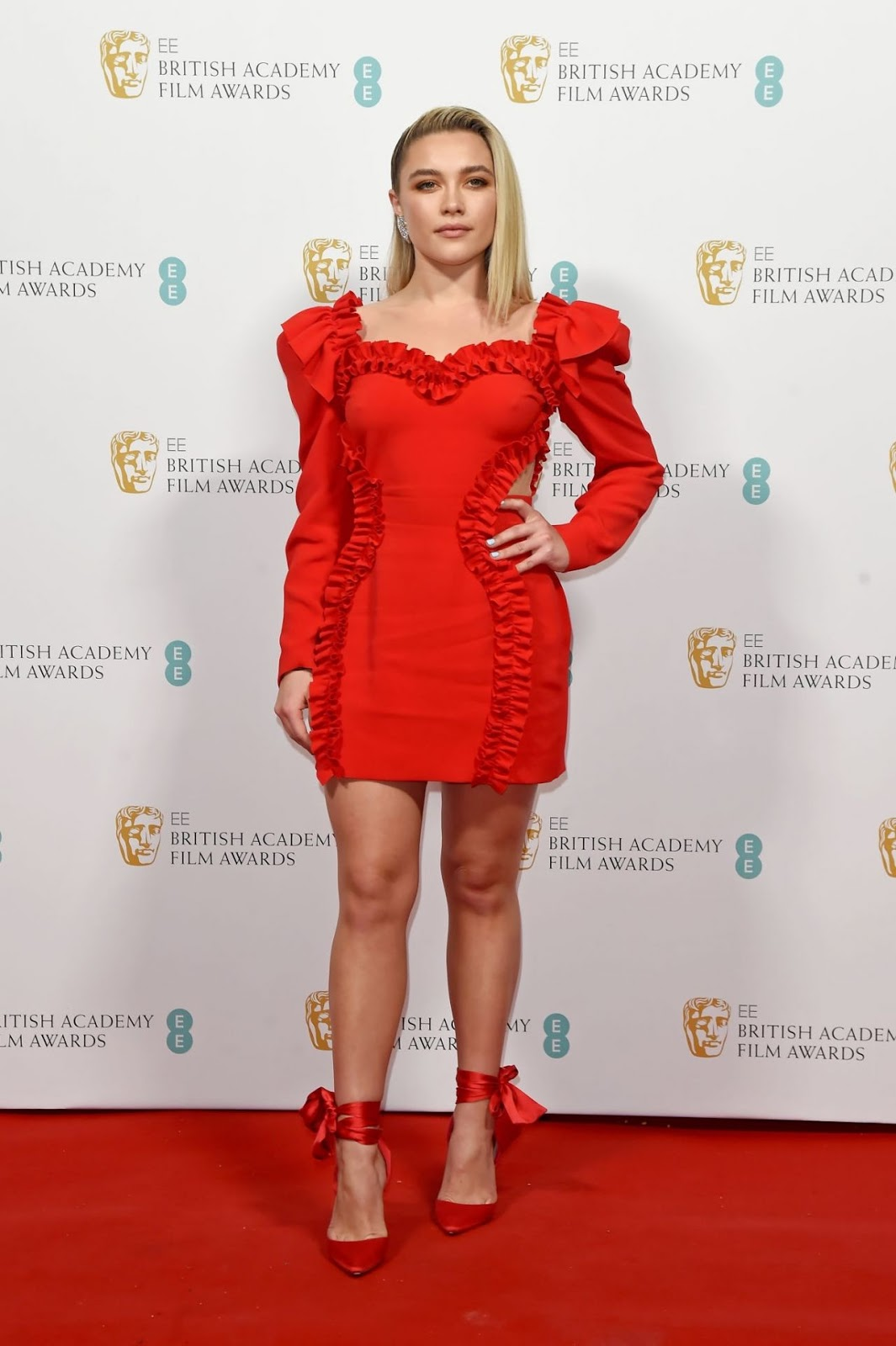 Florence Pugh wows in a red ruffled mini dress