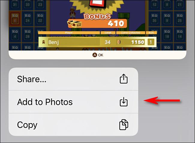 """على iPhone ، انقر على """"إضافة إلى الصور""""."""