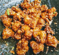 Tossed cauliflower florets in dark soya sauce for Gobi Manchurian recipe