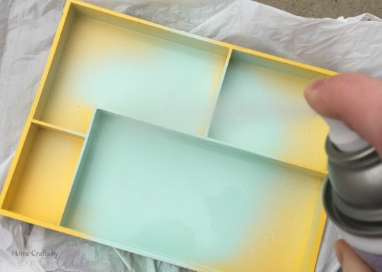 spray an even layer lightly over the multi-sectioned tray