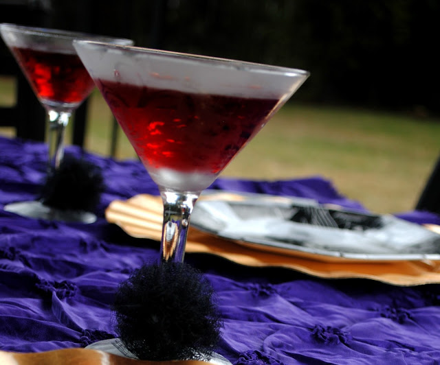 Tulle poms by Fizzy Party add a touch of fun and texture to cocktail glasses