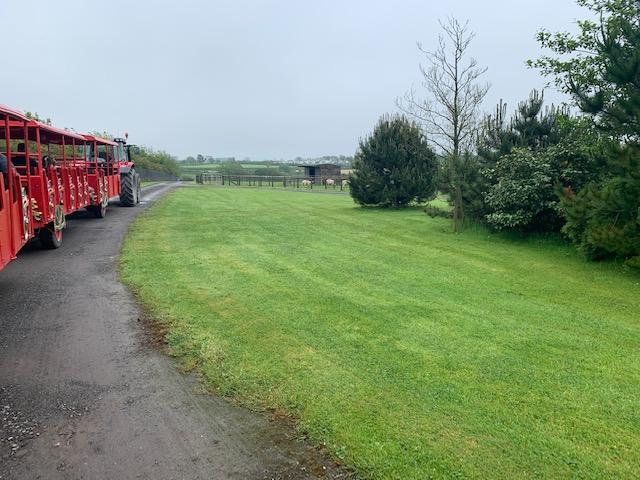 Red land train going around a farm