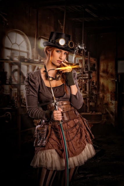 A woman dress in steampunk clothing (goggles, hat, skirt, striped stockings) lighting a cigar with a torch.