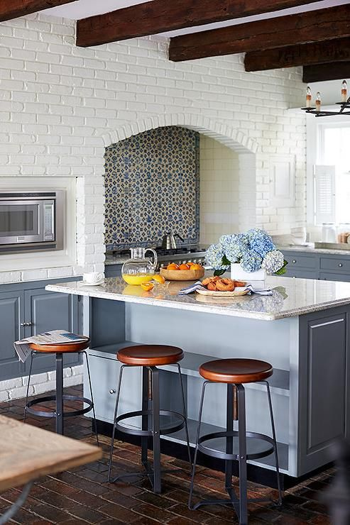 white-brick-kitchen-blue-tile