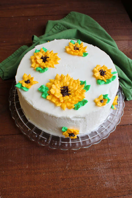 layer cake with 3D frosting sunflowers on top