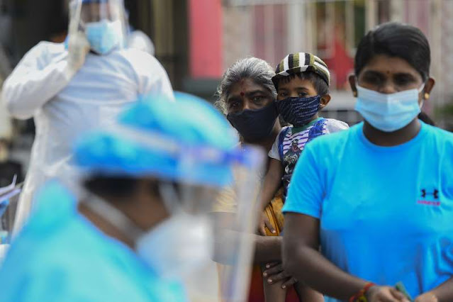 Thousands in Sri Lanka drink 'miracle' COVID potion, sick minister