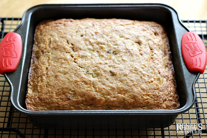 Healthy Carrot Cake by Renee's Kitchen Adventures cooling on a rack in a pan unfrosted
