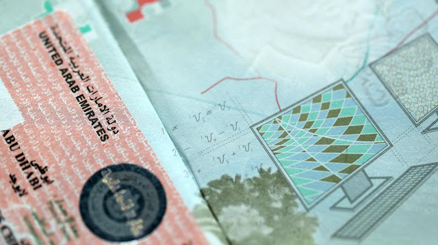 "UAE ""pauses"" visas in response to ""World Health"" raising the Coronavirus to a ""pandemic"" level"