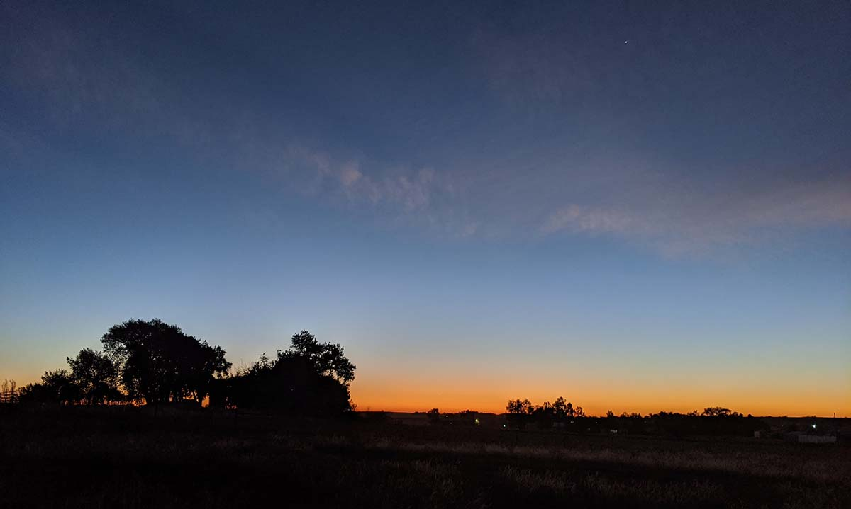 The morning sunrise with Venus over the horizon.