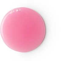 A circular pool of neon baby pink shower gel on a bright background