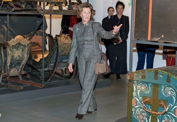 Queen Sonja of Norway wore a Prince of Wales checked peplum blazer wool pants suit by Michael Kors collection. Crown Princess Mette-Marit