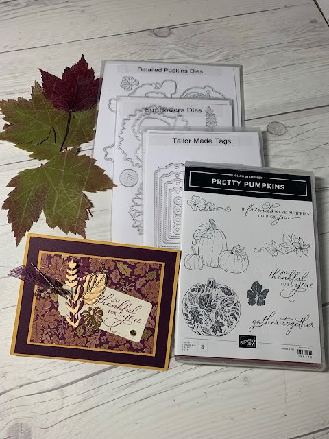 Press Fall leaves next to craft items used to create this fall-themed greeting card