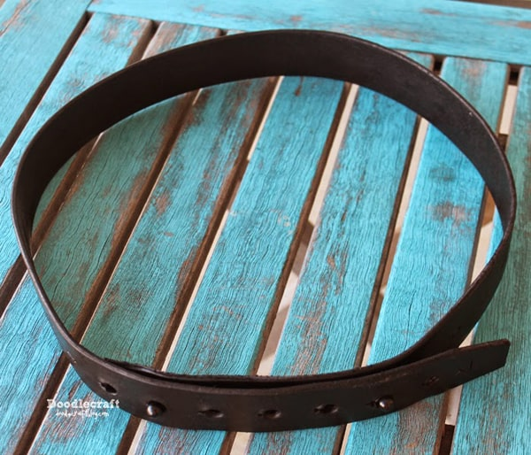 leather belt with 2 studs instead of a traditional buckle