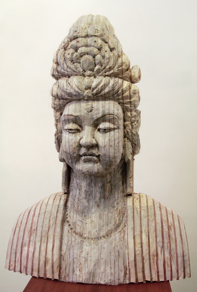 11-Avalokitesvara-Bodhisattva-Buddhas-Long-Bin-Chen-A-Second-Life-for-Recycled-Book-Sculpting-www-designstack-co