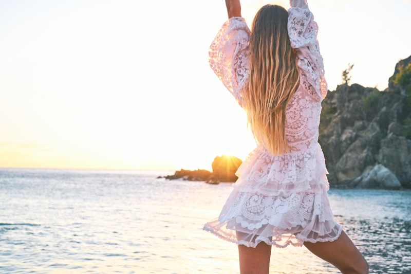 Model Caroline Kelley poses in LoveShackFancy x Superga lookbook