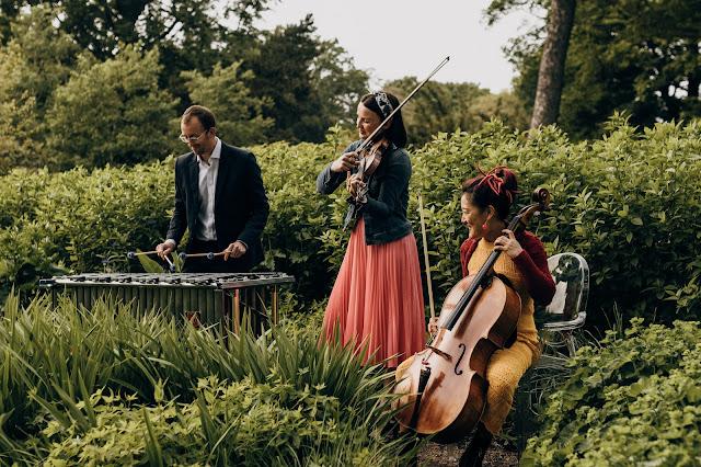 Jenna Reid (fiddle), Su-a Lee (cello) and Iain Sandilnds (percussion) perform in the Royal Botanic Garden Edinburgh to celebrate the launch of the 2021 Edinburgh International Festival programme (Photo Ryan Buchanan)