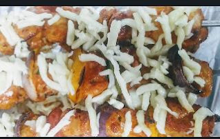 Topping mozzarella cheese over chicken Shewer for mozzarella chicken kebab recipe