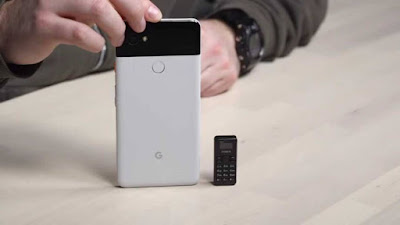 Google Pixel 2 XL placed beside the world smallest phone