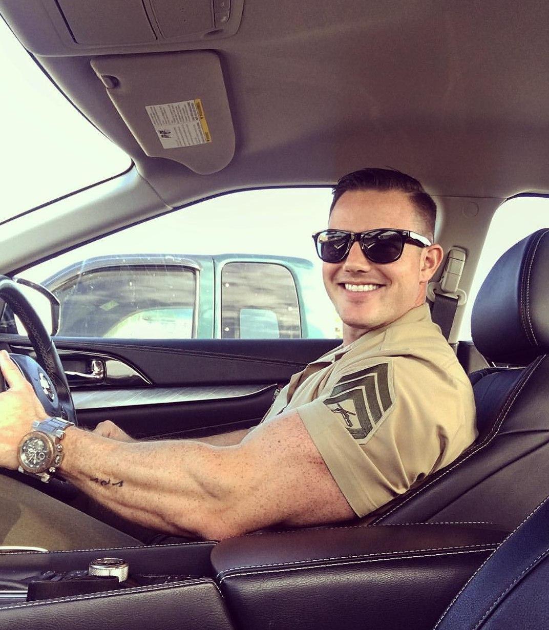 cute-hunky-car-driver-smiling-wearing-uniform-sunglasses-huge-muscle-biceps