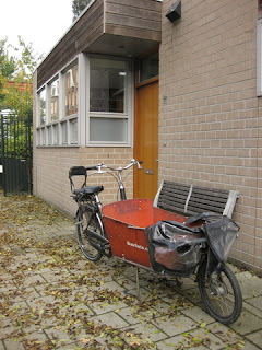 Bakfiets cargo bicycle with a plastic canopy, Amsterdam, The Netherlands