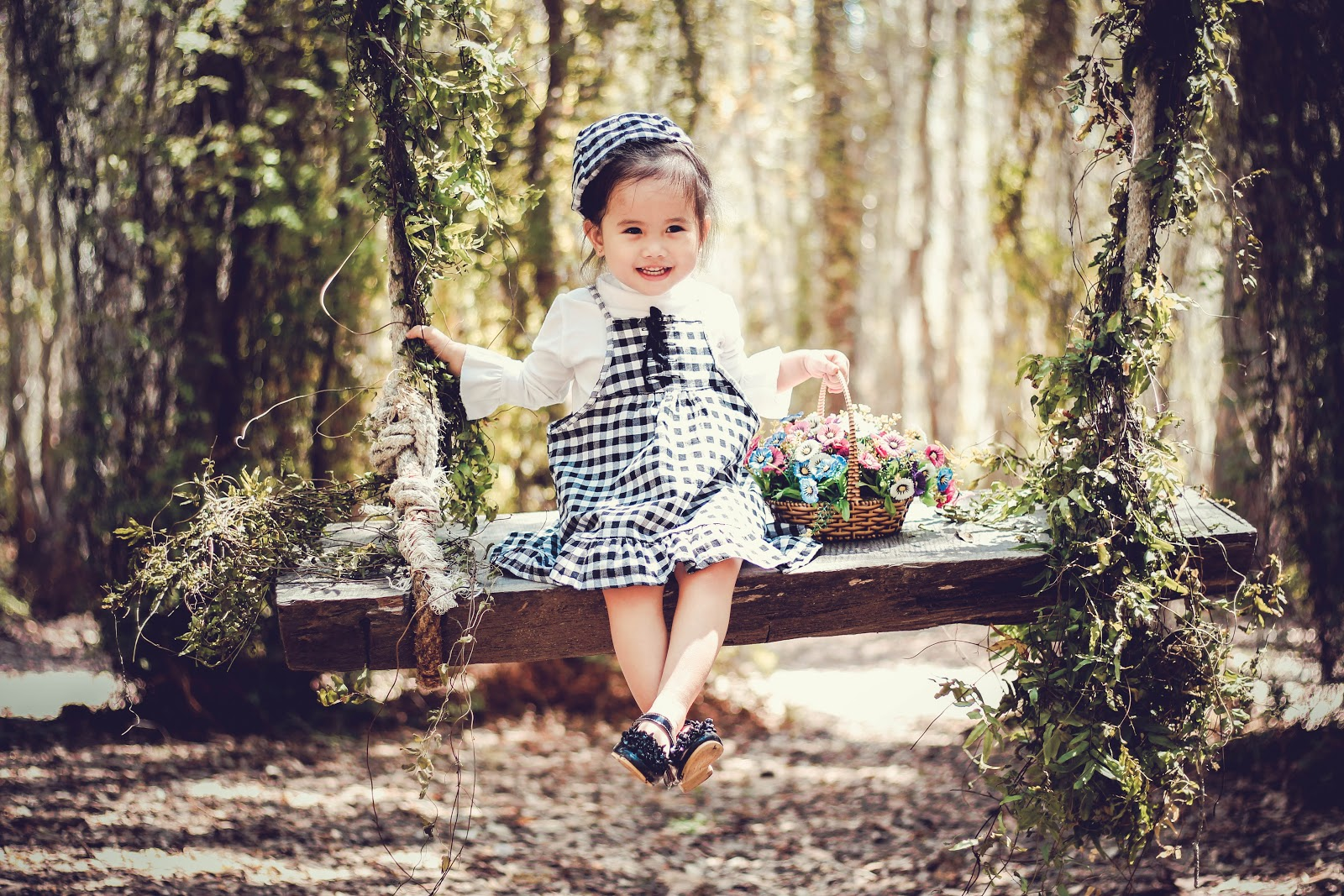 girl-in-black-and-white-overall-skirt-holding-basket-baby-images