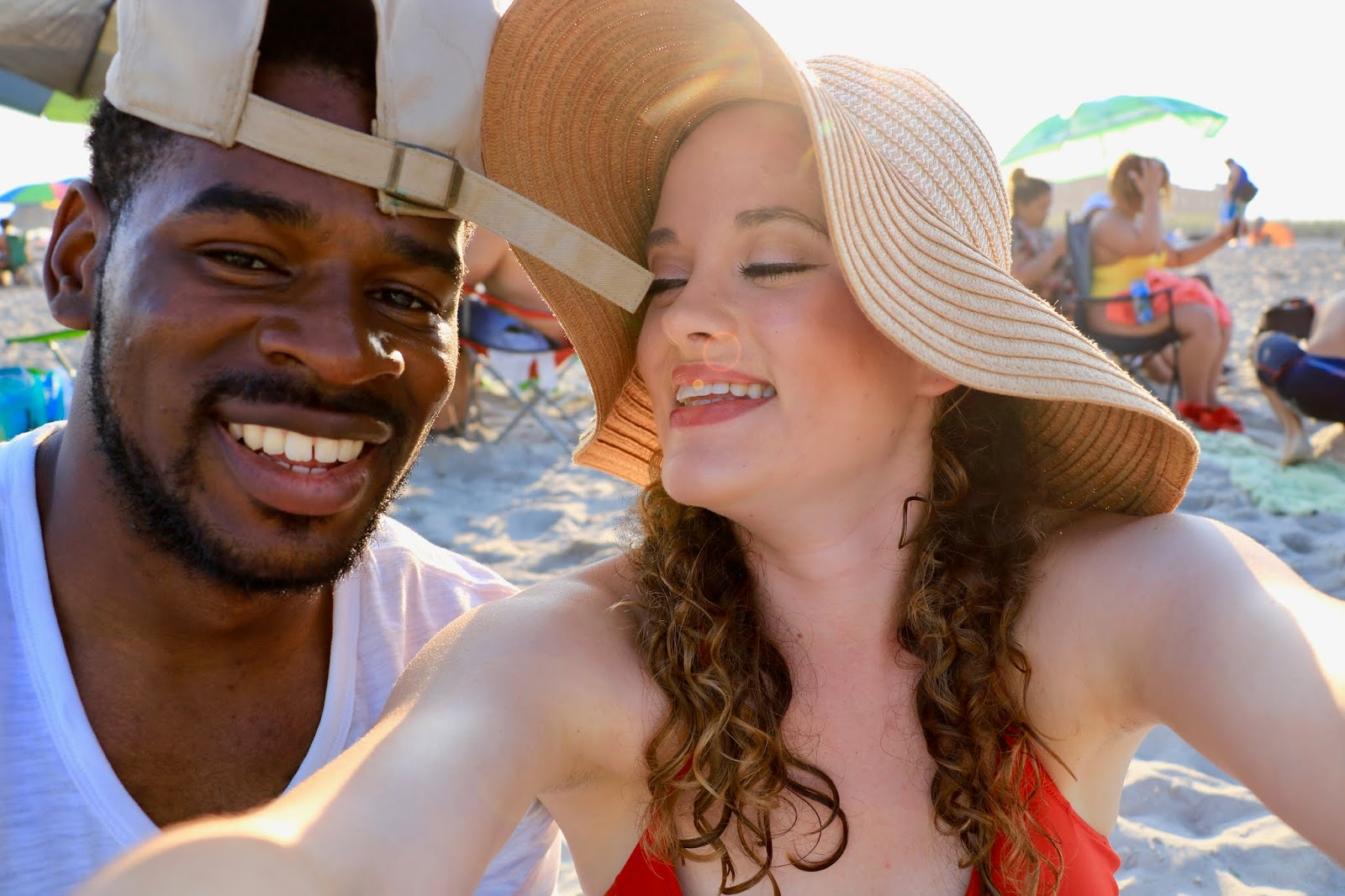 Nyc fashion blogger Kathleen Harper taking a beach selfie with Antonio Owens