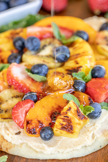 drizzling grilled fruit pizza with honey