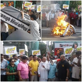 Dummy of Ranil set on fire ... saying that detaining Wimal in remand is unjustified