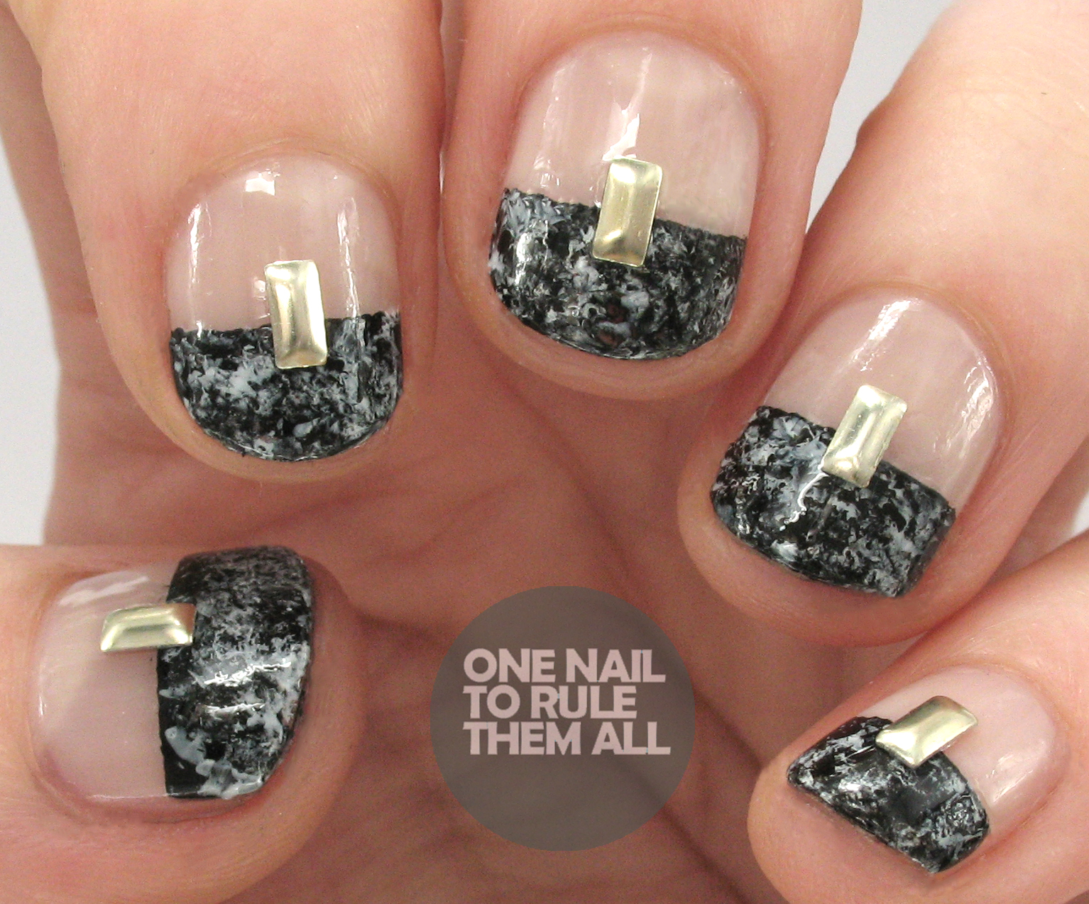 One nail to rule them all paint all the nails presents marble i also create a tutorial for these over at divine caroline so you can see that here if you want to create these yourself solutioingenieria Images