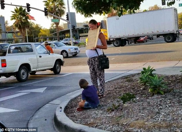 http://www.dailymail.co.uk/news/article-2830761/Outraged-shopper-captures-pregnant-woman-son-begging-money-driving-MERCEDES-BENZZ.html