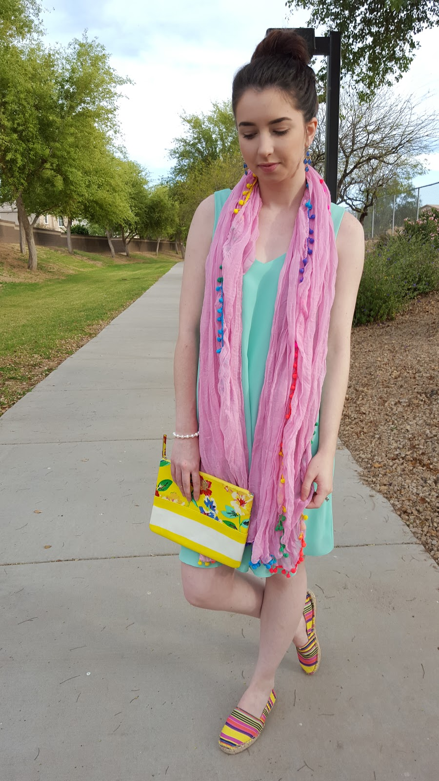 colorful Spring and Summer outfit idea- a flowy dress with a pompom scarf and espadrilles