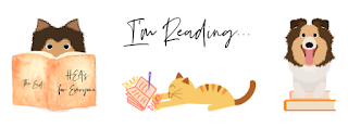 2 sable shelties reading and 1 orange cat in the middle writing in a journal