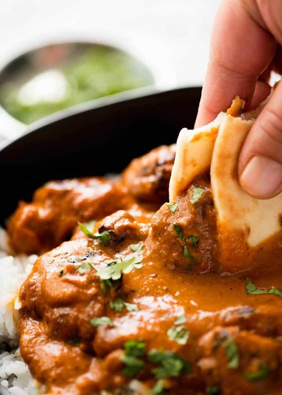 A made-from-scratch Chicken Tikka Masala recipe with the signature yoghurt marinated chargrilled chicken smothered in an incredible spice infused curry sauce. It's astonishingly straightforward – and no hunting down hard to find ingredients!