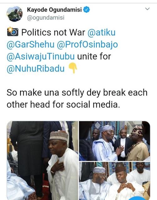Buhari's Top Aide, Garba Shehu Spotted Kneeling Before Atiku, Nigerians React (Photo)