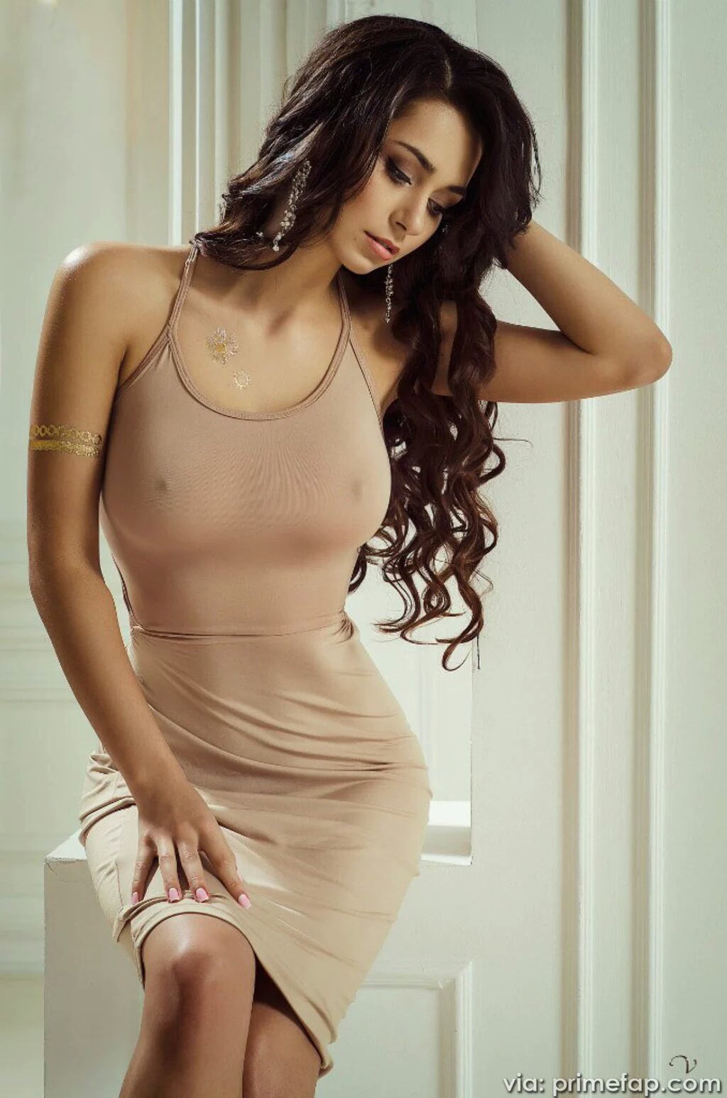Sexy girl taking her clothes off stock photos