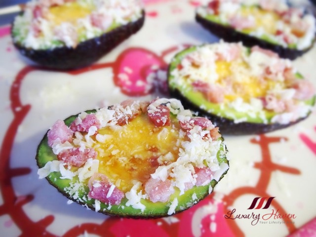 mozzarella cheese baked eggs in avocado with bacon