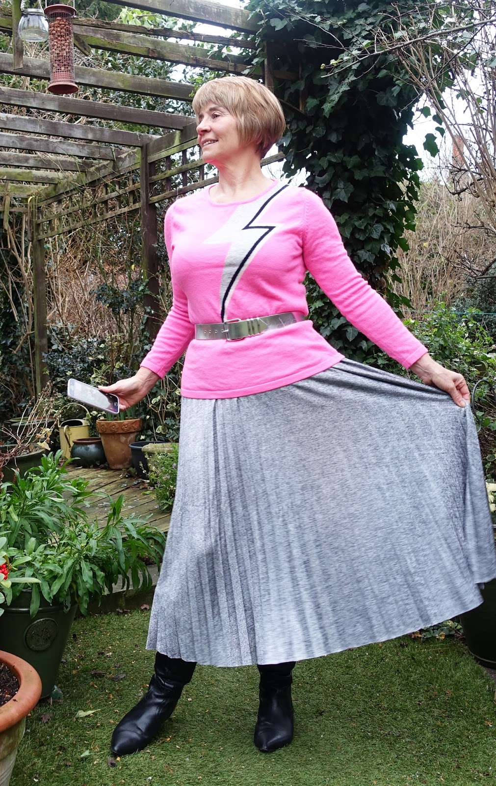 Image showing over 45s blogger Gail Hanlon in pink Bowie cashmere jumper and silver pleated skirt