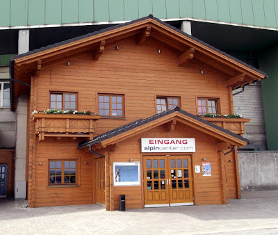 Image of the Alpine chalet entrance at the AlpinCenter Bottrop