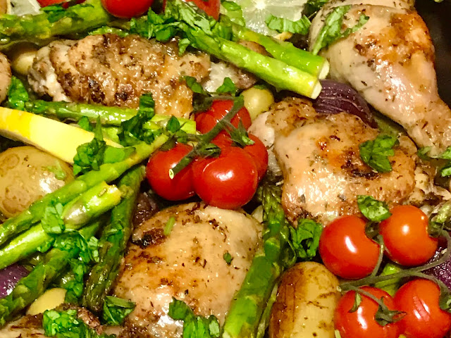 Greek herby chicken tray bake with asparagus, tomatoes, potatoes and red onion
