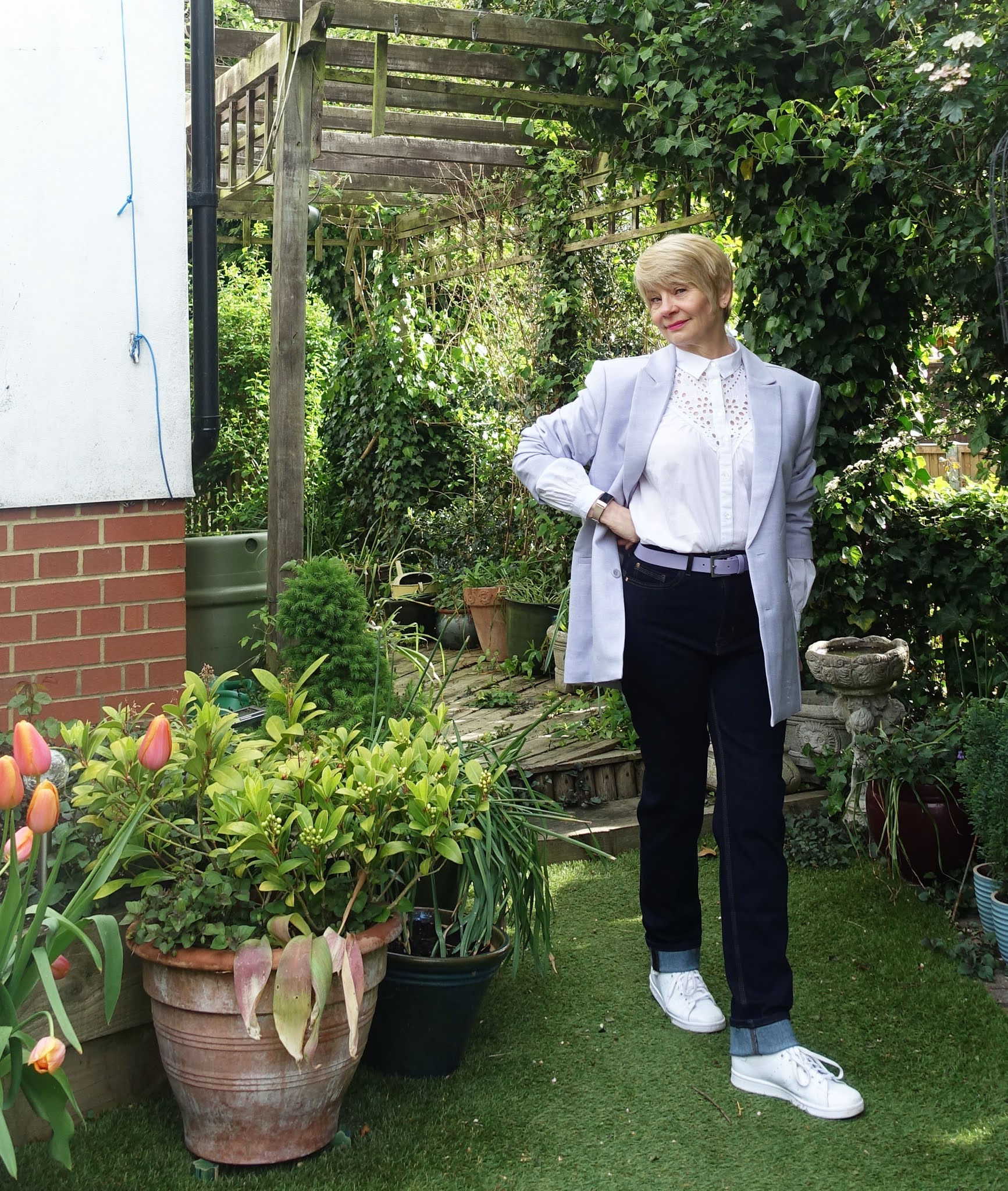 Orange tulips frame Is This Mutton blogger Gail Hanlon wearing casual outfit of lilac blazer, jeans and white blouse