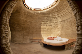 The curved inside of a house printed from earth