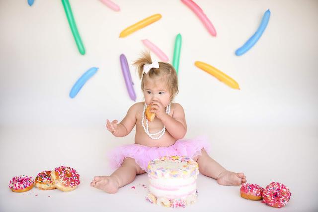 eating donut during cake smash