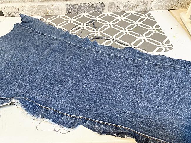 leg of blue jeans cut into a rectangel