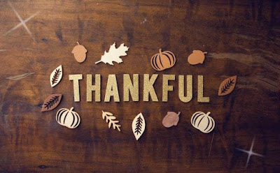 Thanksgiving thankful image on brown leaf and pumpkin background