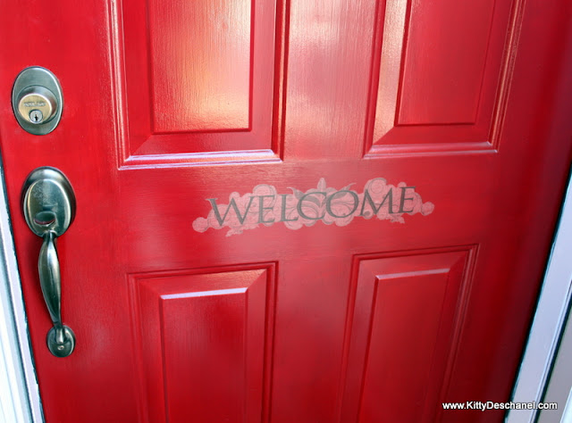 welcome decal on a red front door
