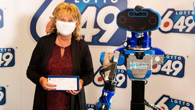 a winner was handed a $6 million check from a life-sized robot built by college students, according to lottery officials.